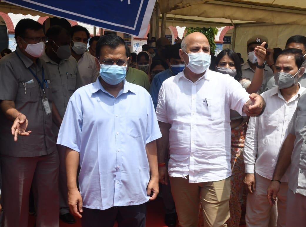 Kejriwal visits vaccination centre, says people happy over getting jabs at polling booths