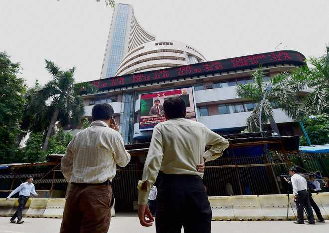 Sensex, Nifty fall from record highs, investors eye US Fed meet