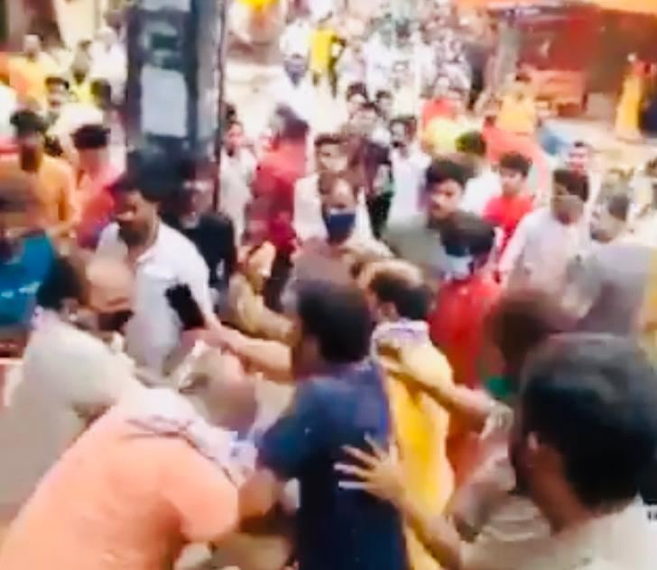 Priest who performed 'pujas' for Gandhi family, Big B beaten up in clash with police; video goes viral