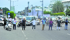 Trash raises stink as workers protest