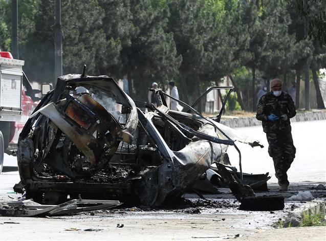 7 dead in Kabul as bombs hit 2 minivans