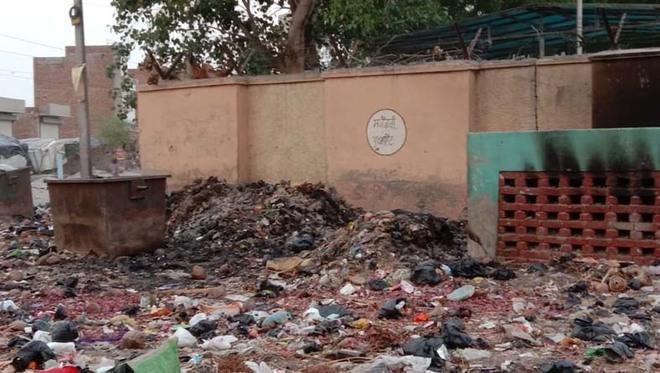 Amid staff strike, garbage set on fire