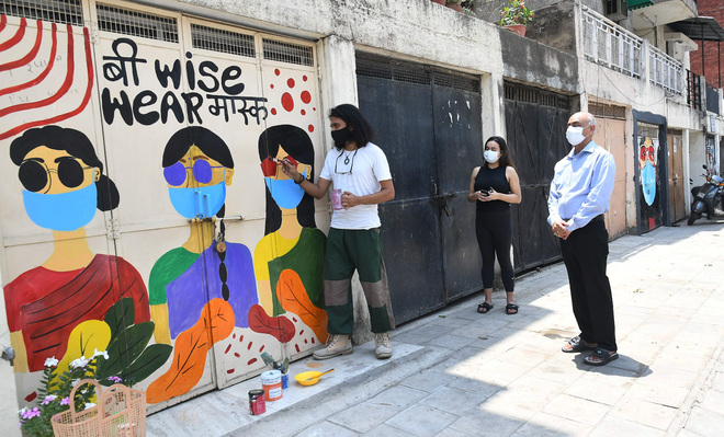 Chandigarh artist paints Covid-19 messages on garages