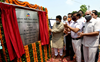 Speaker lays stone for beautification of drain