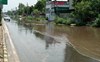 Showers leave city roads inundated