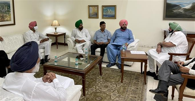 Sidhu seeks action on 18 point agenda; Amarinder says all issues in advanced stages of resolution