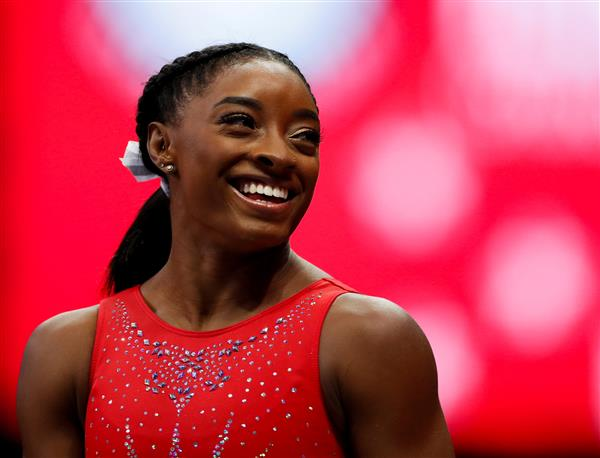 Gymnastics: Biles pushes her limits by doing the 'unimaginable'