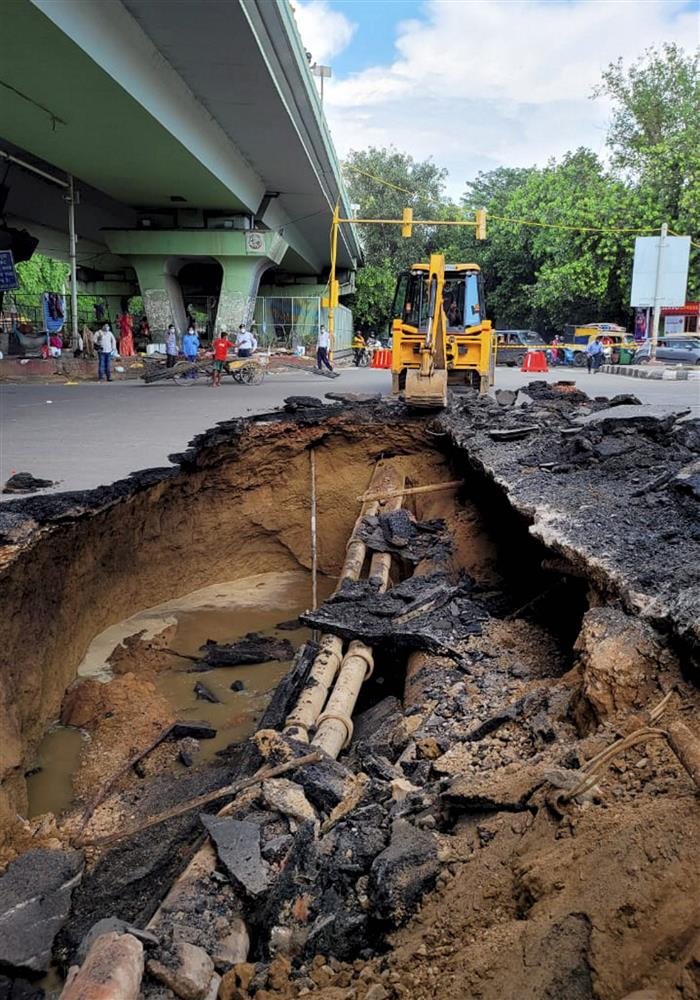 Traffic hit as portion of road under IIT-Delhi flyover caves in