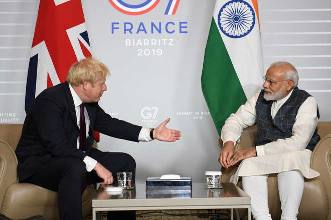 Johnson-Modi handshake on bypoll leaflet spurs row