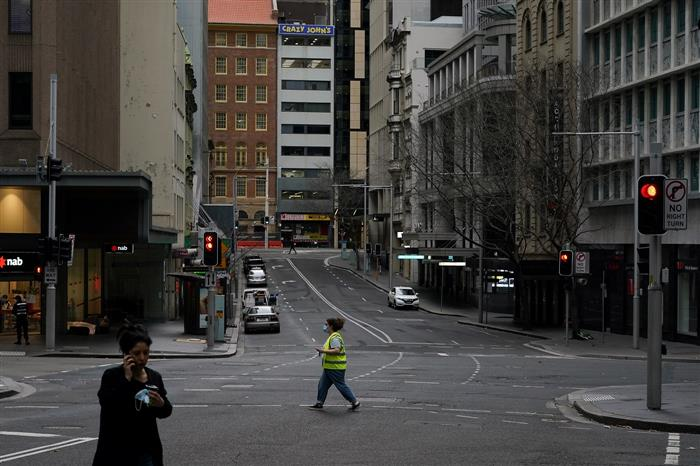 Covid-19 cases surge in Sydney, police cordon off downtown to prevent protest