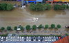 Tens of thousands evacuated as China storms spread northwards