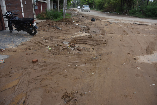 Road dug up for laying sewer pipes troubles commuters in BRS Nagar, Ludhiana