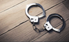 Two booked for embezzling funds