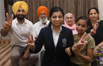 Two cousins from St Xavier's, YPS girl top tricity with 99.75%