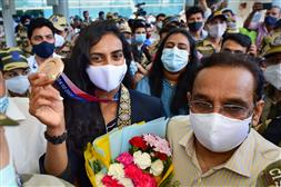 After winning bronze at Tokyo Olympics, PV Sindhu returns to warm reception