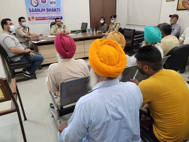 Police hold meeting with farmers laying siege to Adani logistics park at Kila Raipur in Ludhiana