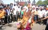 Sanitation workers burn draft of employees' Bill