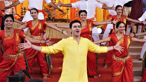 Gautam in a devotional song