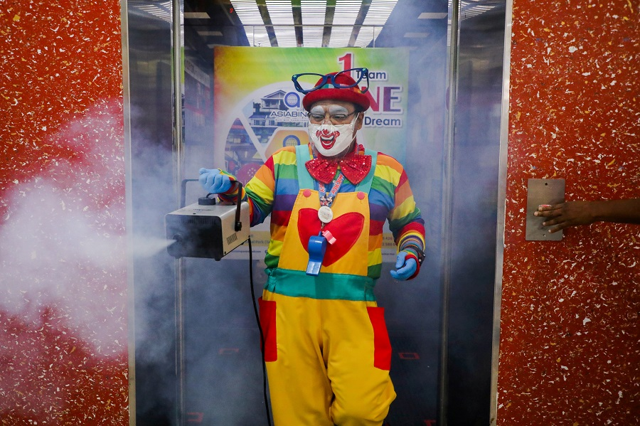 Malaysia's germ-busting clown finds new role in pandemic
