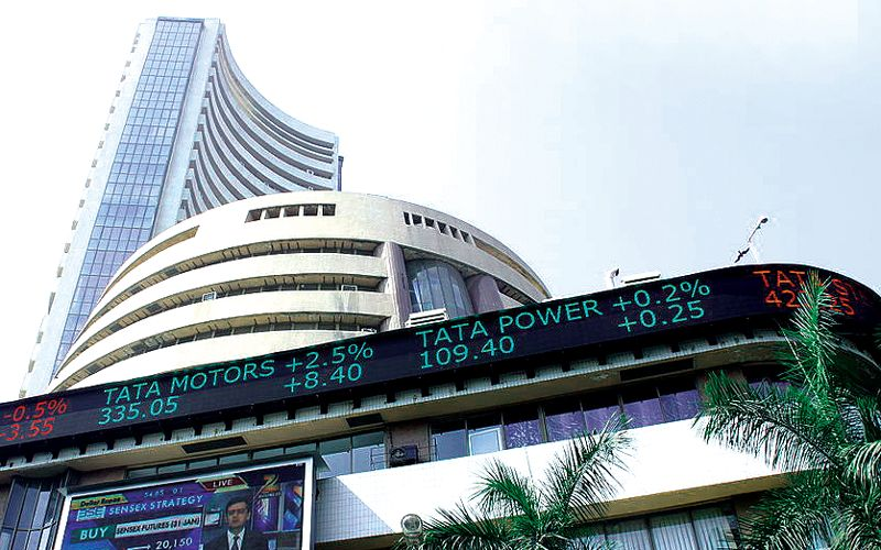Markets pull back from record highs on profit-booking; log weekly gains