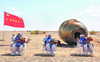 China astronauts return after 90 days in space