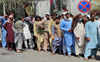 Taliban hand over seized cash, gold to Afghan bank as thousands withdraw their savings