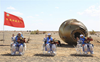 Chinese astronauts safely return to Earth after 90 days; mission to build space station successful