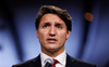 Canada's Justin Trudeau, trailing in polls, defends early election call