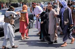 Viral photo: Woman protester stands fearlessly as Taliban man in Kabul points gun at her