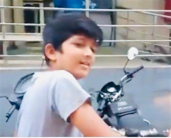 Telangana minister impressed with 12-year-old boy delivering newspapers on his bicycle
