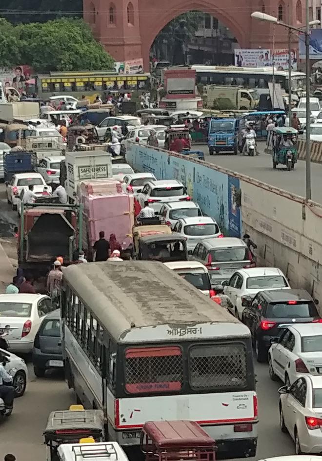 Protest on Bhandari bridge in Amritsar brings traffic to a standstill