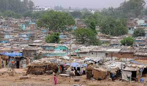 Property rights conferred on 35 families of slums
