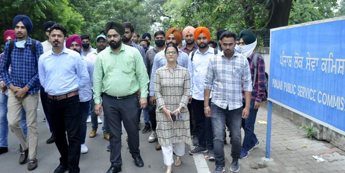 Applicants hold demonstration outside commission office in Patiala