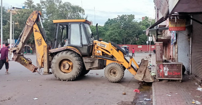 Amritsar Civic body removes illegal structures, encroachments